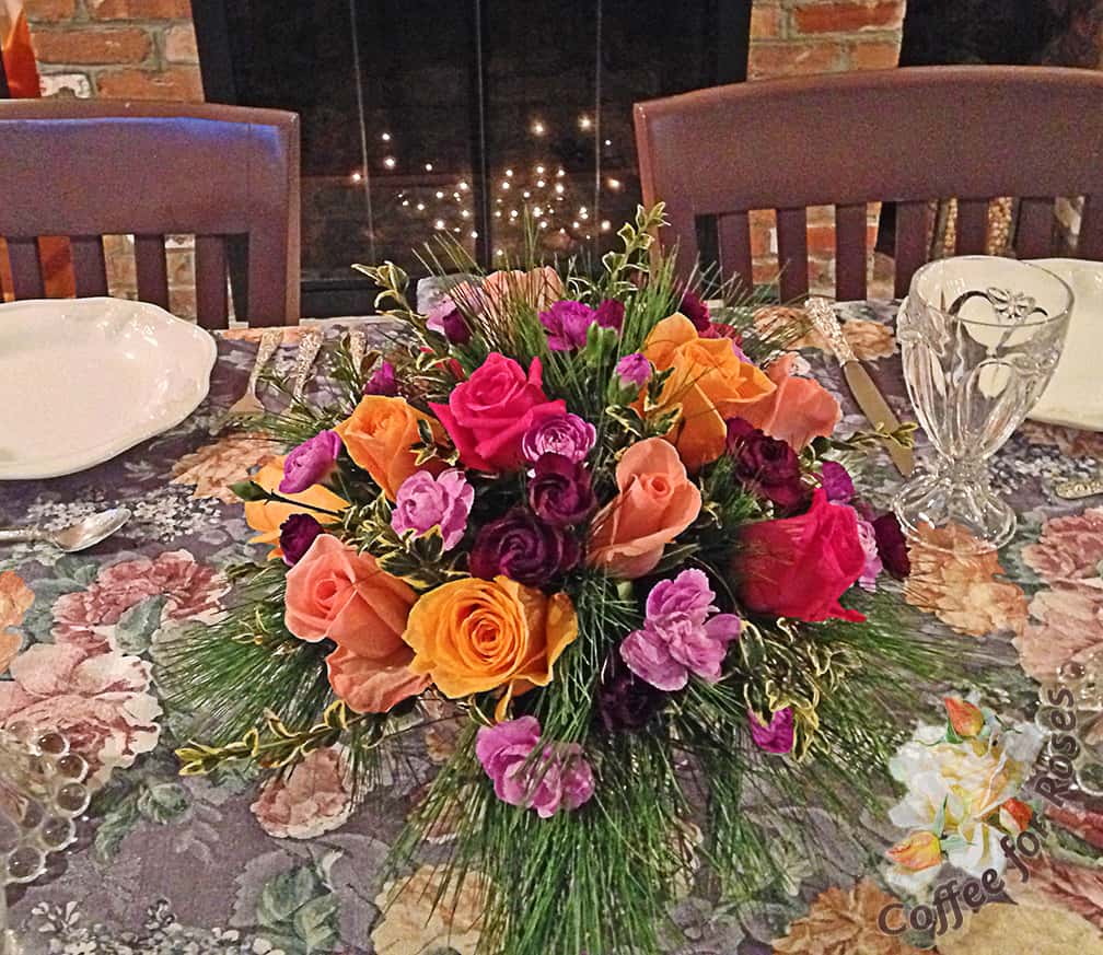 Here's an arrangement I did last year using roses, carnations, white pine and