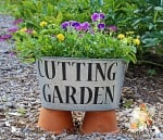 I love the look of galvanized metal in the garden, so in this area I used several old containers that function as planters and signs.