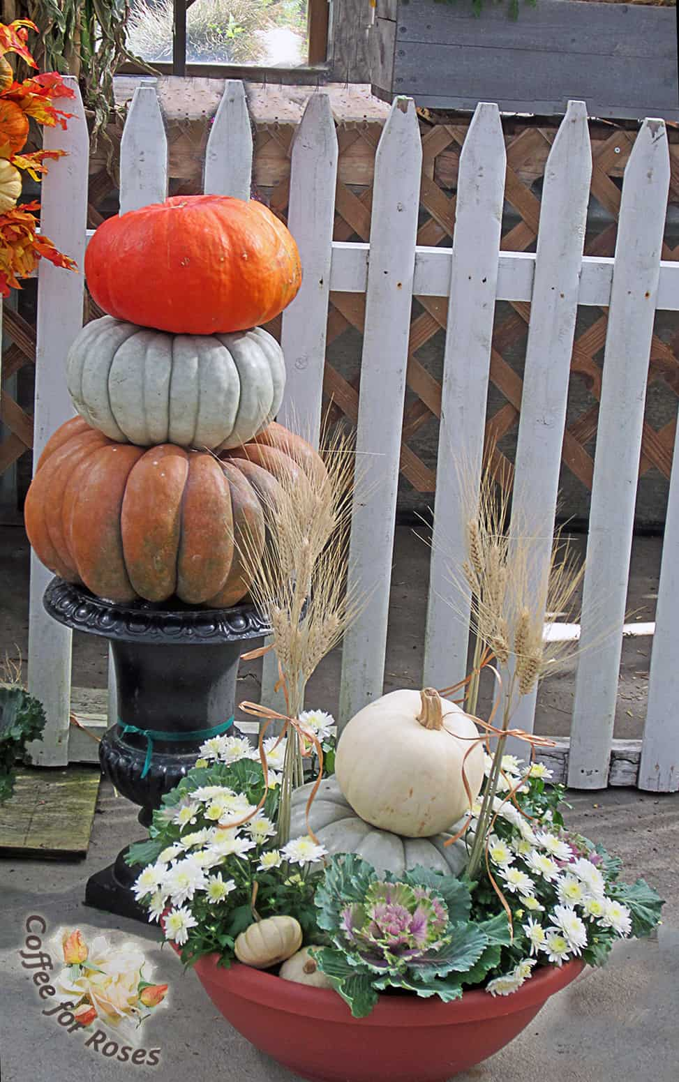 An urn is the perfect base for a pumpkin stack.