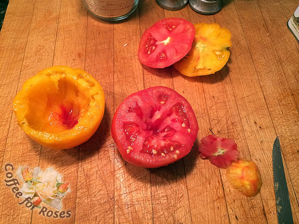 Cut the tops off of the tomatoes and save them. Don't worry if they are cracked or not that pretty - they will be transformed in the cooking process and help keep the rice moist.