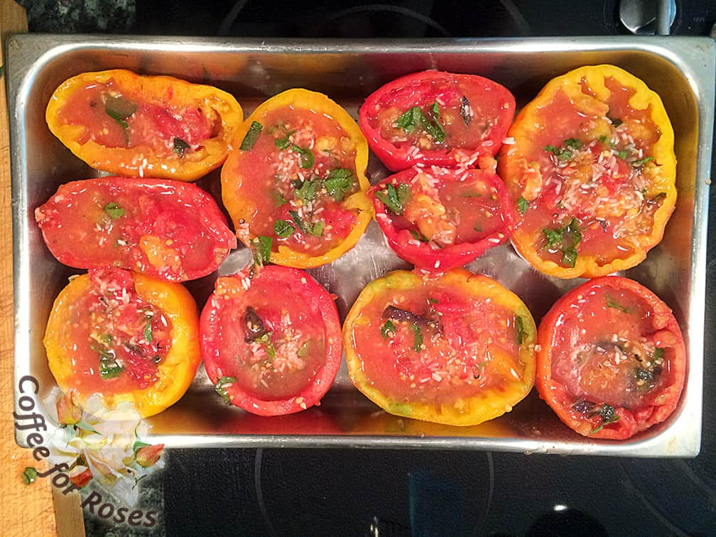 Fill the hollowed out tomatoes with the rice, oil, tomato, herb mixture. Fill each shell almost to the top. The rice will spill over into the pan when it's cooking which is OK.
