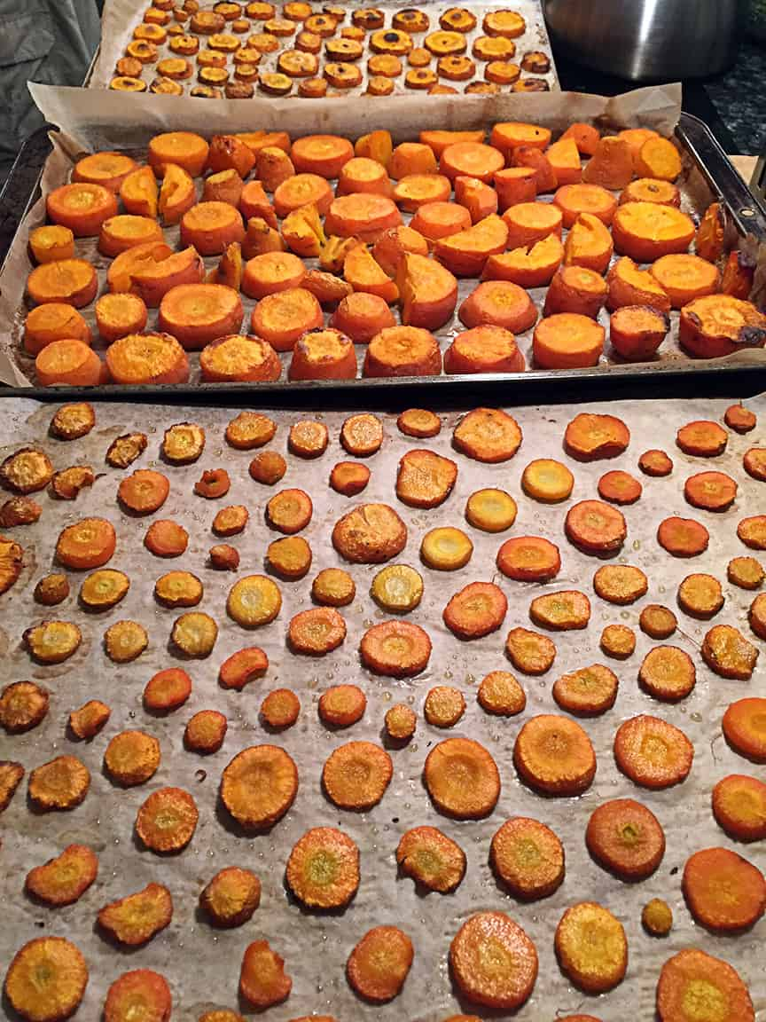 We slice the carrots into various sizes and place them on parchment paper in a 375 oven. Roast until they are starting to brown and are soft - roasting brings out the sweetness. Cook these before piling them into zip-lock freezer bags.
